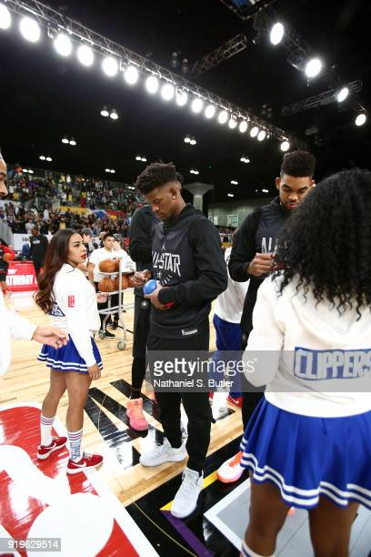 Jimmy Butler and KarlAnthony Towns of Team Stephen sign autographs during the NBA AllStar practice as part of the 2018 NBA AllStar Weekend on...