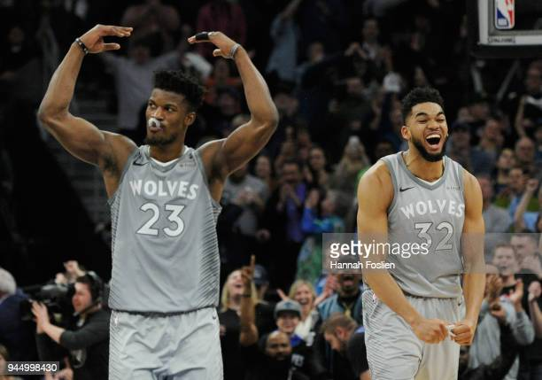 Jimmy Butler and KarlAnthony Towns of the Minnesota Timberwolves celebrate in the final minute of overtime of the game against the Denver Nuggets on...