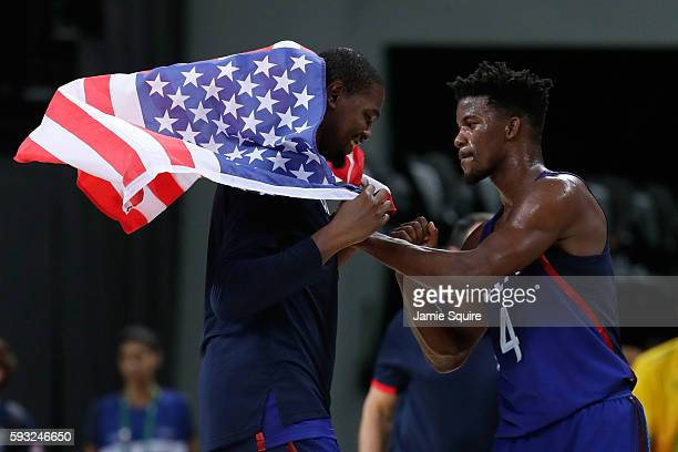Jimmy Butler and Kevin Durant of United States celebrates after defeating Serbia during the Men's Gold medal game on Day 16 of the Rio 2016 Olympic...