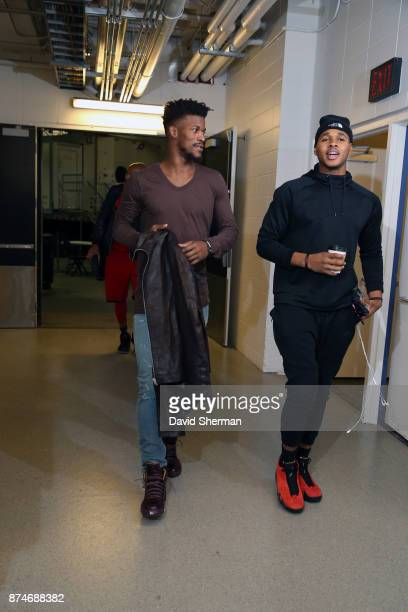 Jimmy Butler and Marcus GeorgesHunt of the Minnesota Timberwolves arrive before the game against the San Antonio Spurs on November 15 2017 at Target...