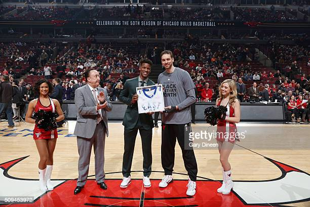 Jimmy Butler honors Pau Gasol of the Chicago Bulls with an All Star jersey during the game against the Atlanta Hawks on February 10 2016 at United...