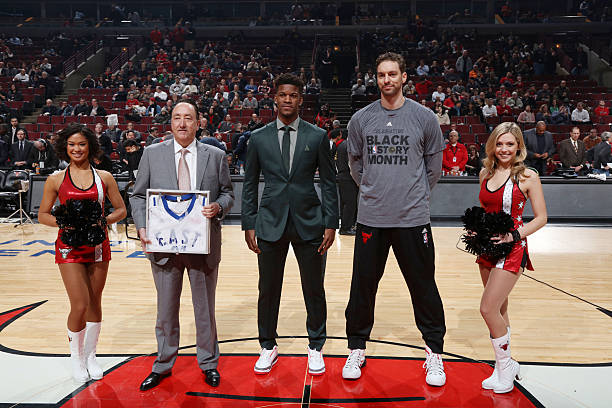 Jimmy Butler honors Pau Gasol of the Chicago Bulls with an All Star jersey during the game against the Atlanta Hawks on February 10, 2016 at United...
