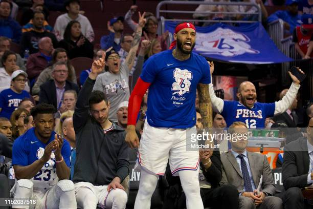 Jimmy Butler JJ Redick and Mike Scott of the Philadelphia 76ers react from the bench against the Toronto Raptors in Game Six of the Eastern...