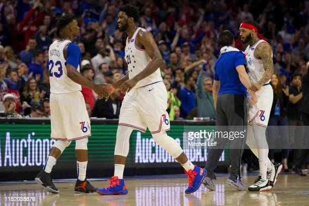 Jimmy Butler, Joel Embiid, T.J. McConnell, and Mike Scott of the Philadelphia 76ers react against the Toronto Raptors in Game Six of the Eastern...