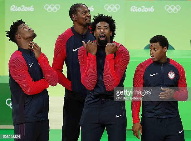 Jimmy Butler Kevin Durant DeAndre Jordan and Kyle Lowry of United States wait for the medal ceremony following the Men's Gold medal game on Day 16 of...