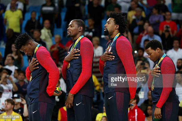 Jimmy Butler Kevin Durant DeAndre Jordan and Kyle Lowry of United States stand on the podium for the National Anthem after defeating Serbia in the...