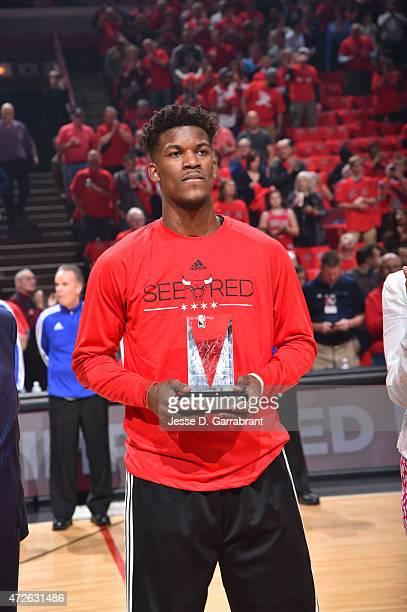Jimmy Butler of the Chicago Bulls accepts his most improved player award prior to the game against the Cleveland Cavaliers at the United Center...