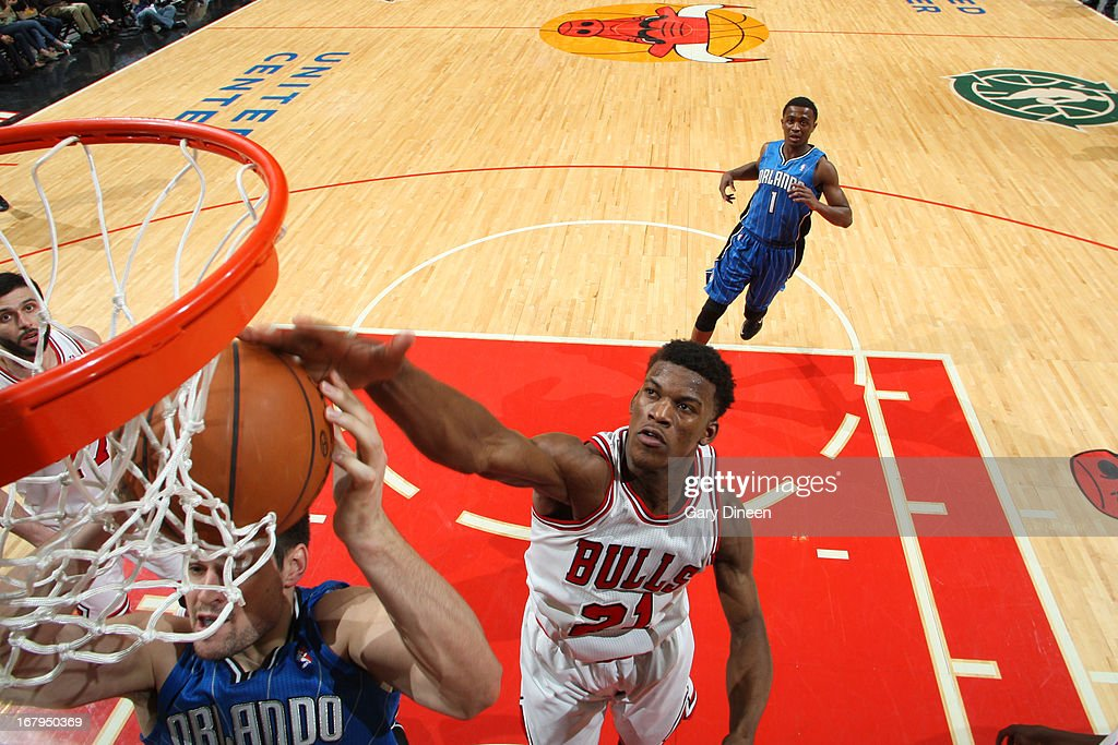 Jimmy Butler #21 of the Chicago Bulls blocks the shot of an Orlando Magic player on April 05, 2013 at the United Center in Chicago, Illinois.