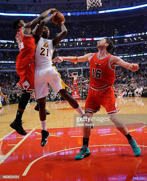 Jimmy Butler of the Chicago Bulls blocks the shot of Ed Davis of the Los Angeles Lakers during the second half on December 25 2014 at the United...