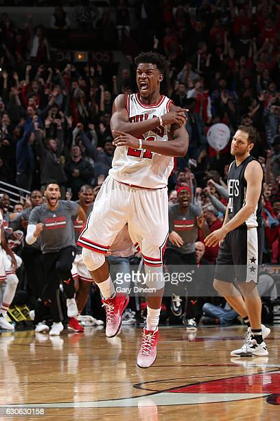 Jimmy Butler of the Chicago Bulls celebrates after making the game winning shot against the Brooklyn Nets on December 28 2016 at the United Center in...