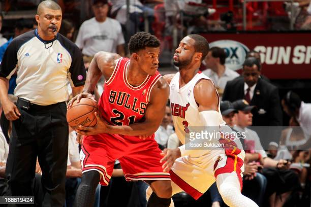 Jimmy Butler of the Chicago Bulls controls the ball against Dwyane Wade of the Miami Heat in Game Five of the Eastern Conference Semifinals during...