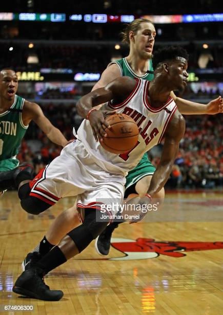 Jimmy Butler of the Chicago Bulls drives around Kelly Olynyk of the Boston Celtics during Game Six of the Eastern Conference Quarterfinals during the...