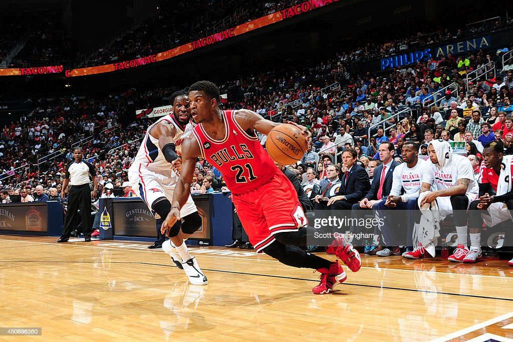 Jimmy Butler #21 of the Chicago Bulls drives to the basket against the Atlanta Hawks on April 2, 2014 at Philips Arena in Atlanta, Georgia.