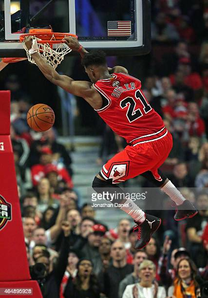 Jimmy Butler of the Chicago Bulls dunks against the Los Angeles Clippers at the United Center on March 1 2015 in Chicago Illinois The Clippers...