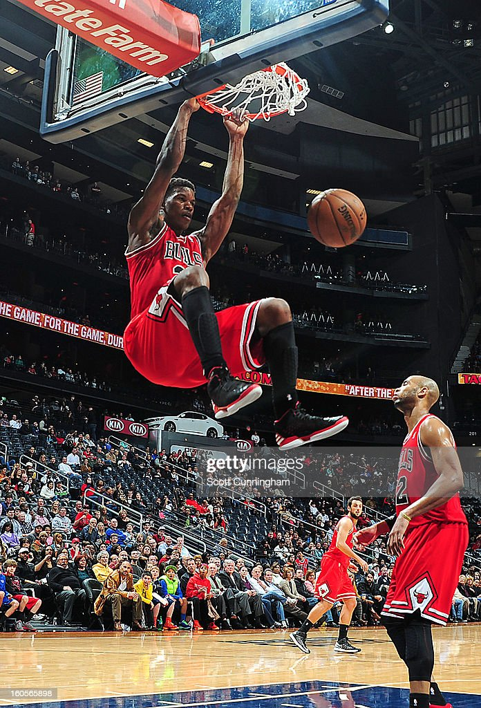 Jimmy Butler #21 of the Chicago Bulls dunks the ball against the Atlanta Hawks on February 2, 2013 at Philips Arena in Atlanta, Georgia.