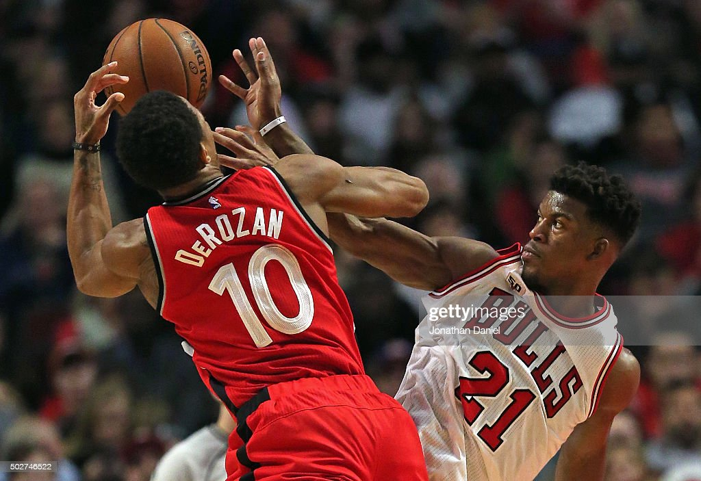Jimmy Butler #21 of the Chicago Bulls fouls DeMar DeRozan #10 of the Toronto Raptors at the United Center on December 28, 2015 in Chicago, Illinois. The Bulls defeated the Raptors 104-97.