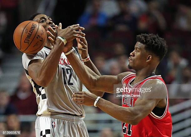 Jimmy Butler of the Chicago Bulls fouls Dwight Howard of the Houston Rockets at the United Center on March 5 2016 in Chicago Illinois The Bulls...