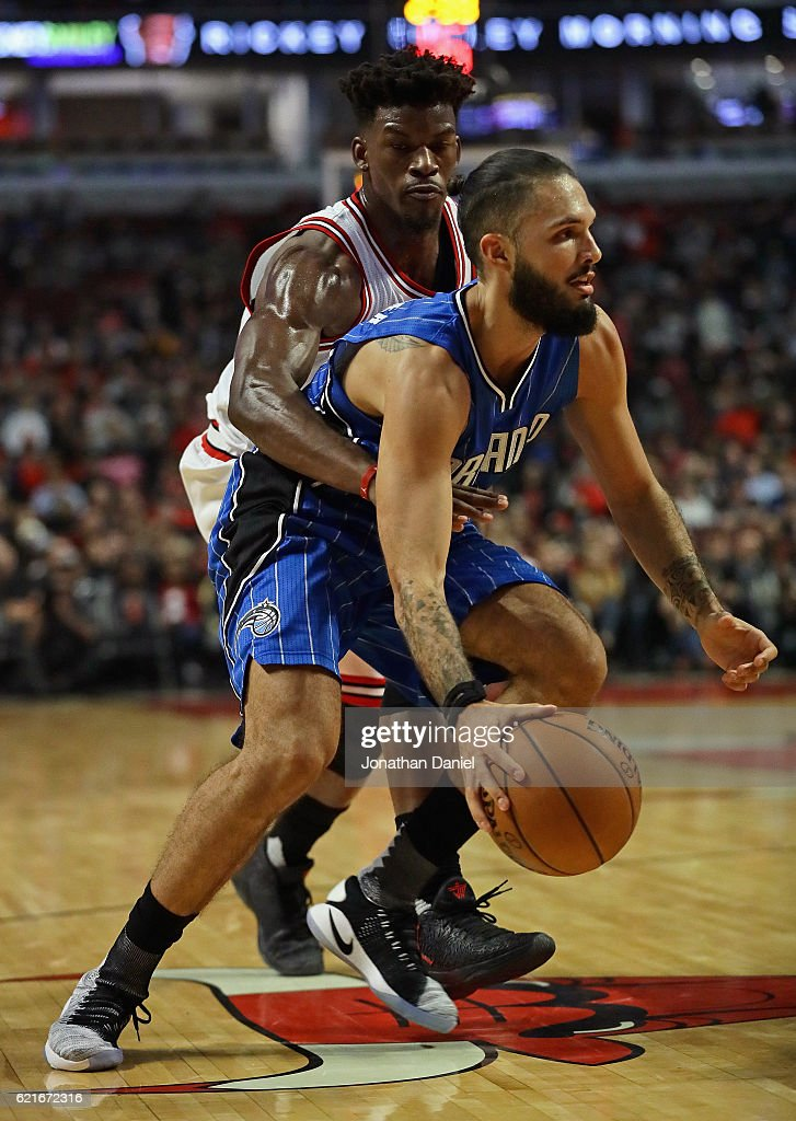 Jimmy Butler #21 of the Chicago Bulls gets his arm around Evan Fournier #10 of the Orlando Magic at the United Center on November 7, 2016 in Chicago, Illinois.