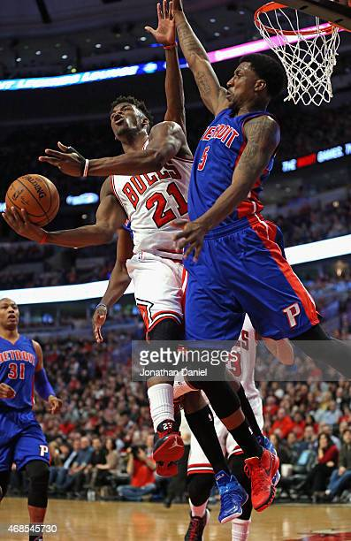 Jimmy Butler of the Chicago Bulls goes up for a shot against Kentavious CaldwellPope of the Detroit Pistons at the United Center on April 3 2015 in...