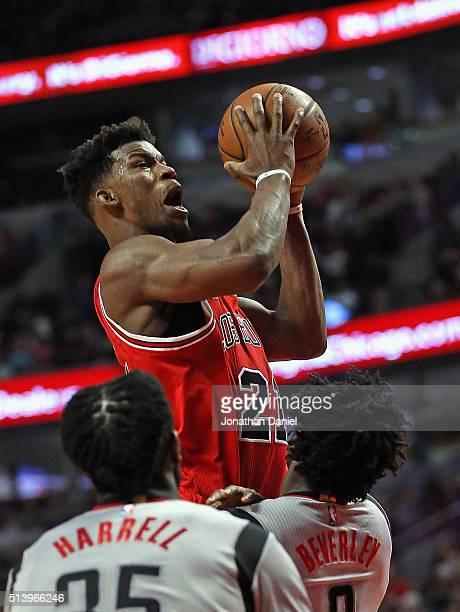 Jimmy Butler of the Chicago Bulls goes up for a shot but is called for a charge against Patrick Beverley of the Houston Rockets at the United Center...