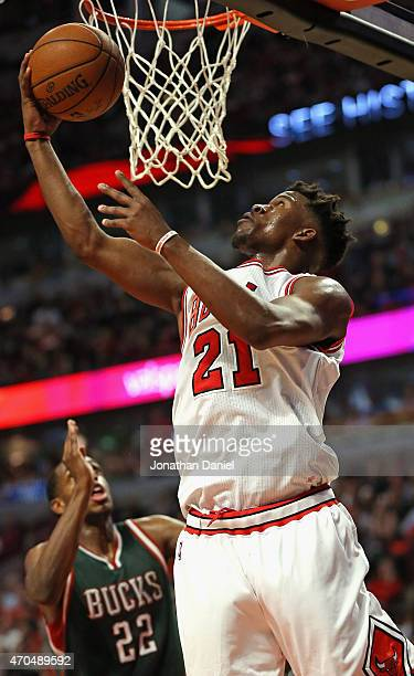 Jimmy Butler of the Chicago Bulls goes up for a shot over Khris Middleton of the Milwaukee Bucks on his way to a gamehigh 31 points during the first...