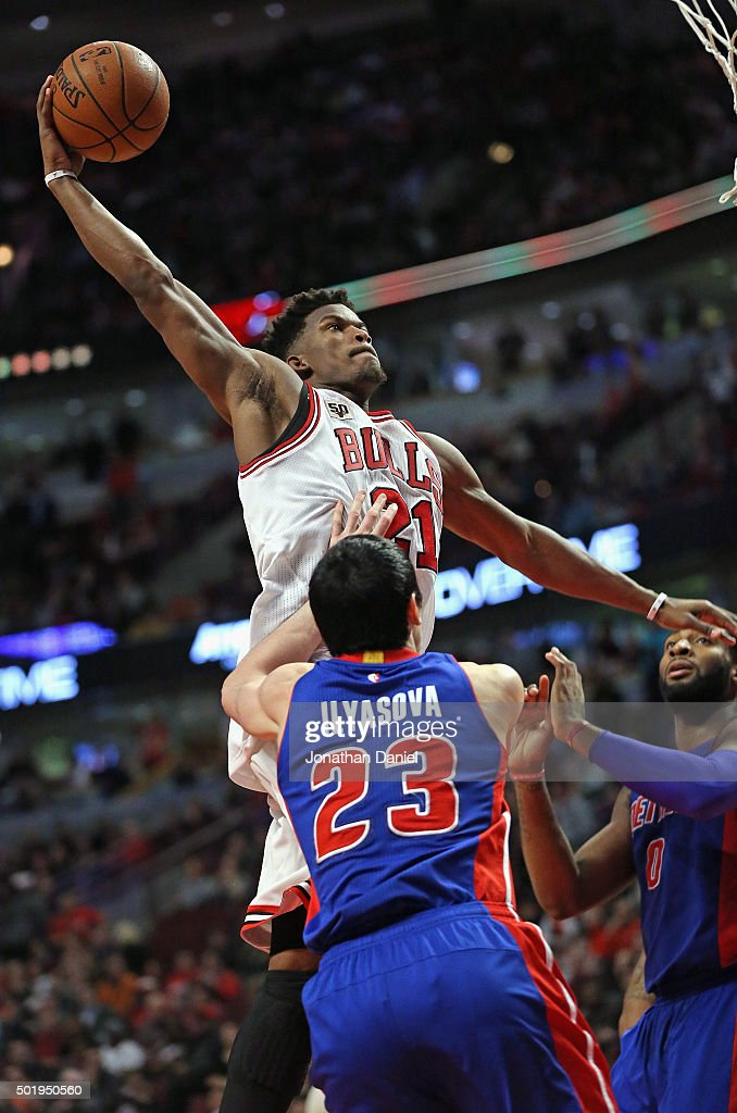 Jimmy Butler #21 of the Chicago Bulls goes up for dunk over Ersan Ilyasova #23 (L) and Andre Drummond #0 of the Detroit Pistons on his way to a game-high 43 points at the United Center on December 18, 2015 in Chicago, Illinois. The Pistons defeated the Bulls 147-144 in quadruple overtime.