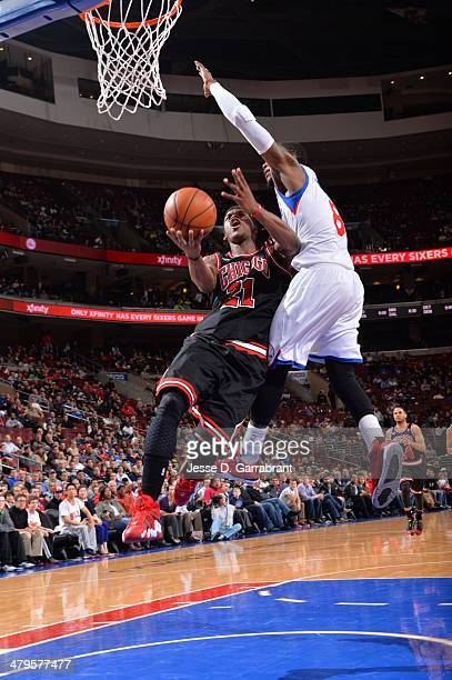 Jimmy Butler of the Chicago Bulls goes up for the layup against the Philadelphia 76ers at the Wells Fargo Center on March 19 2014 in Philadelphia...