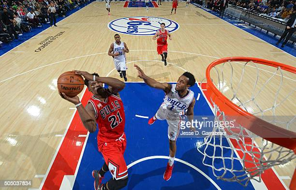 Jimmy Butler of the Chicago Bulls goes up for the layup against the Philadelphia 76ers at Wells Fargo Center on January 14 2015 in Philadelphia...