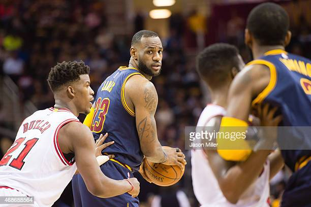 Jimmy Butler of the Chicago Bulls guards LeBron James of the Cleveland Cavaliers during the first half at Quicken Loans Arena on April 5 2015 in...