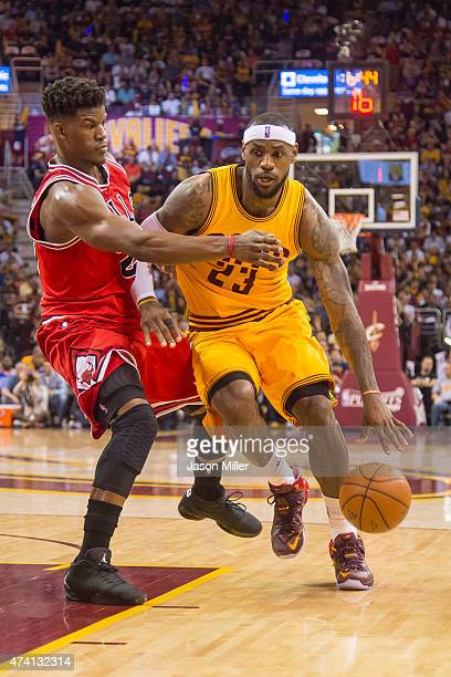 Jimmy Butler of the Chicago Bulls guards LeBron James of the Cleveland Cavaliers in the first half during Game Two in the Eastern Conference...