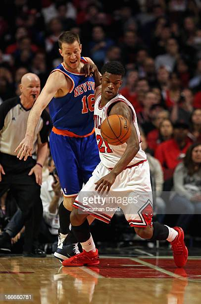 Jimmy Butler of the Chicago Bulls holds off Steve Novak of the New York Knicks at the United Center on April 11 2013 in Chicago Illinois The Bulls...