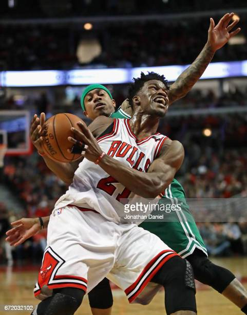 Jimmy Butler of the Chicago Bulls is fouled by Isaiah Thomas of the Boston Celtics during Game Four of the Eastern Conference Quarterfinals during...