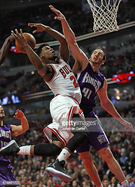 Jimmy Butler of the Chicago Bulls is fouled while shooting by Kosta Koufos of the Sacramento Kings at the United Center on March 21 2016 in Chicago...
