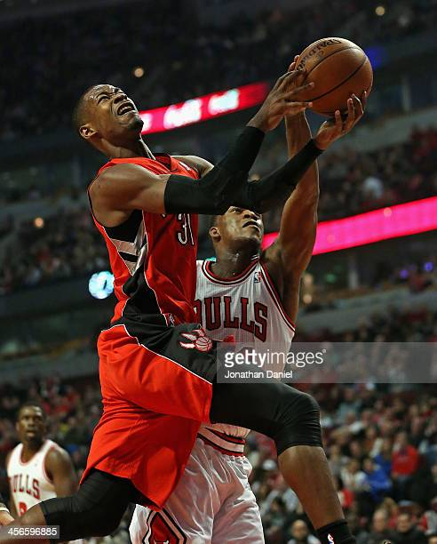 Jimmy Butler of the Chicago Bulls knocks the ball away from Terrence Ross of the Toronto Raptors at the United Center on December 14 2013 in Chicago...