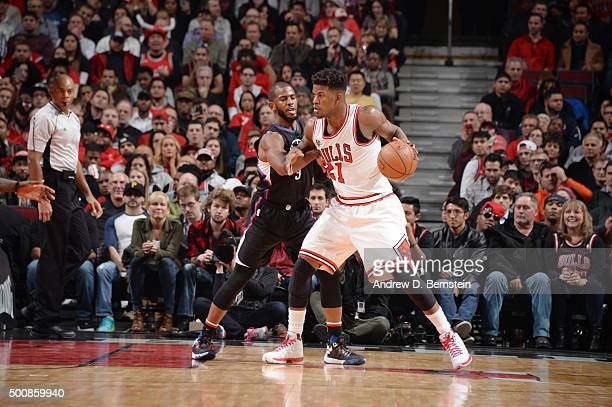 Jimmy Butler of the Chicago Bulls posts up against Chris Paul of the Los Angeles Clippers on December 10 2015 at the United Center in Chicago...