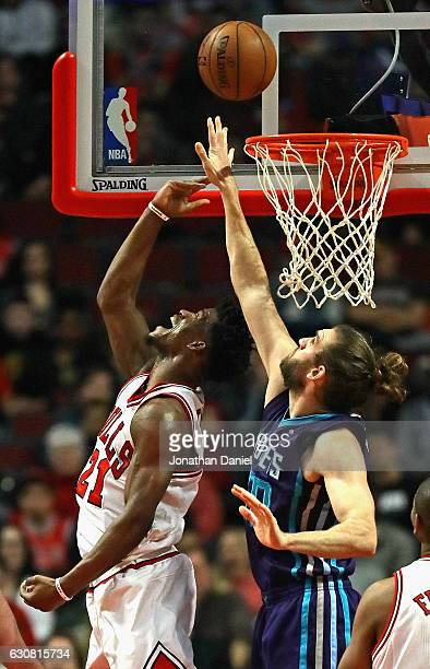 Jimmy Butler of the Chicago Bulls puts in a reverse layup over Spencer Hawes of the Charlotte Hornets at the United Center on January 2 2017 in...