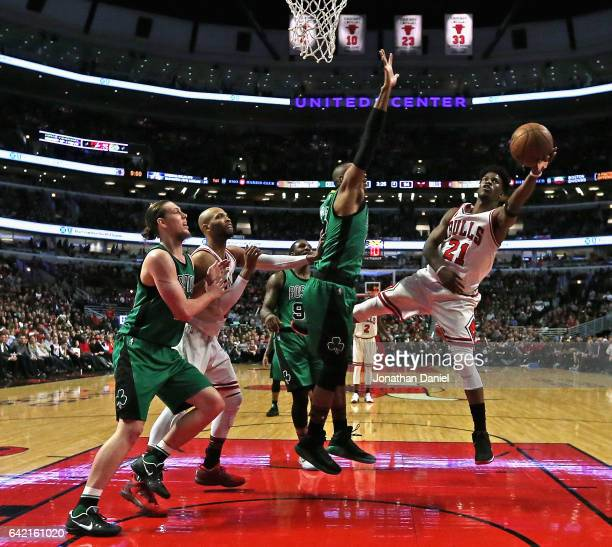 Jimmy Butler of the Chicago Bulls puts up a shot against Al Horford of the Boston Celtics at the United Center on February 16 2017 in Chicago...