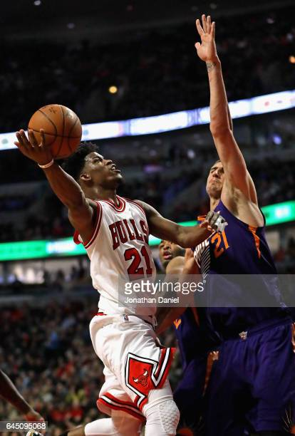 Jimmy Butler of the Chicago Bulls puts up a shot against Alex Len of the Phoenix Suns at the United Center on February 24 2017 in Chicago Illinois...