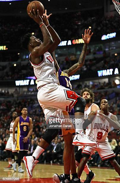 Jimmy Butler of the Chicago Bulls puts up a shot against Brandon Ingram of the Los Angeles Lakers at the United Center on November 30 2016 in Chicago...