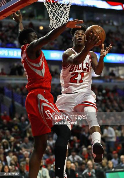 Jimmy Butler of the Chicago Bulls puts up a shot against Clint Capela of the Houston Rockets at the United Center on March 10 2017 in Chicago...