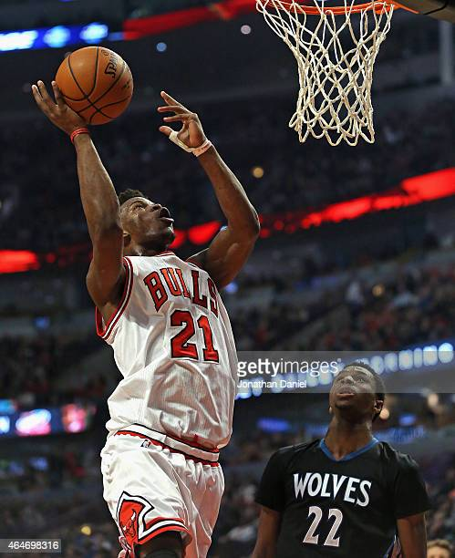 Jimmy Butler of the Chicago Bulls puts up a shot over Andrew Wiggins of the Minnesota Timberwolves on his way to a gamehigh 28 points at the United...