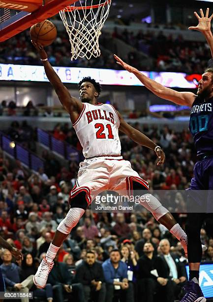 Jimmy Butler of the Chicago Bulls puts up a shot past Spencer Hawes of the Charlotte Hornets on his way to a gamehigh 52 points at the United Center...