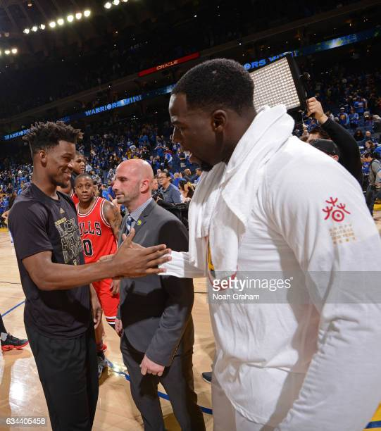 Jimmy Butler of the Chicago Bulls shanes hands with Draymond Green of the Golden State Warriors after the game on February 8 2017 at ORACLE Arena in...