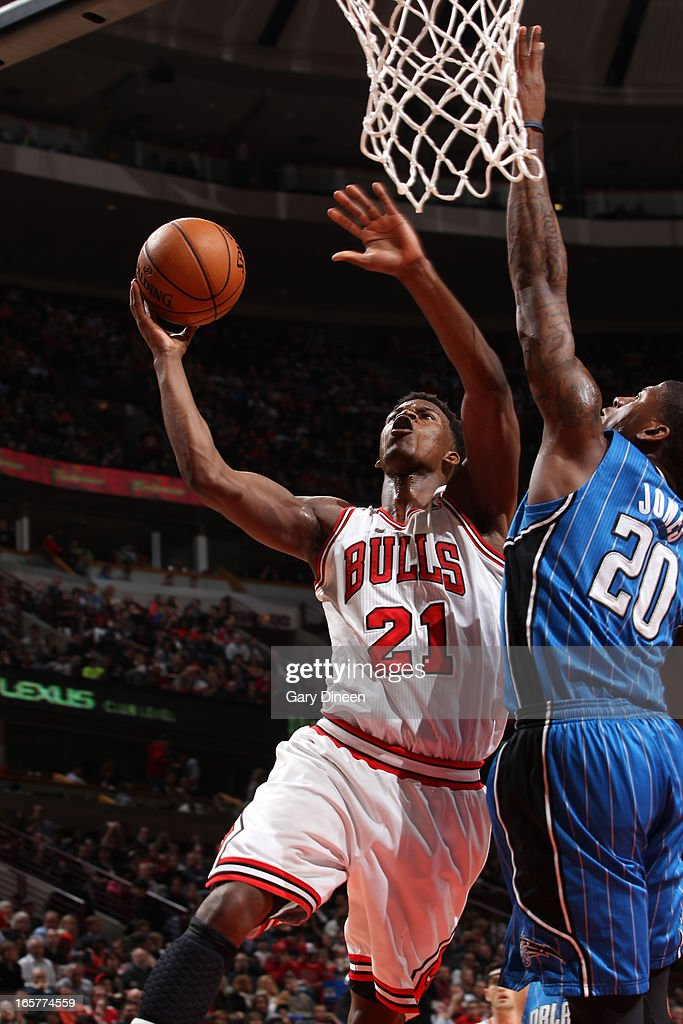 Jimmy Butler #21 of the Chicago Bulls shoots against DeQuan Jones #20 of the Orlando Magic on April 05, 2013 at the United Center in Chicago, Illinois.