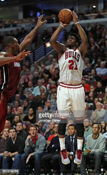 Jimmy Butler of the Chicago Bulls shoots over Chris Bosh of the Miami Heat at the United Center on January 25 2016 in Chicago Illinois The Heat...