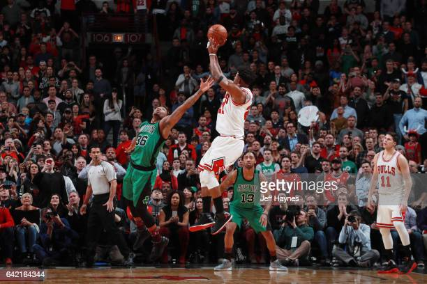 Jimmy Butler of the Chicago Bulls shoots the ball against Marcus Smart of the Boston Celtics during the game on February 16 2017 at the United Center...