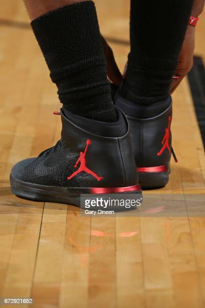 Jimmy Butler of the Chicago Bulls ties his shoes in Game Four of the Eastern Quarterfinals against the Boston Celtics of the 2017 NBA Playoffs on...