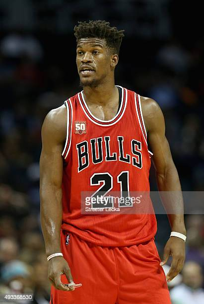 Jimmy Butler of the Chicago Bulls watches on against the Charlotte Hornets during their game at Time Warner Cable Arena on October 19 2015 in...