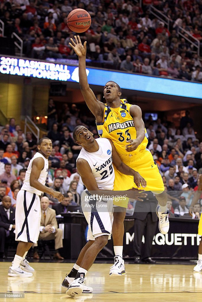 Jimmy Butler of the Marquette Golden Eagles drives to the