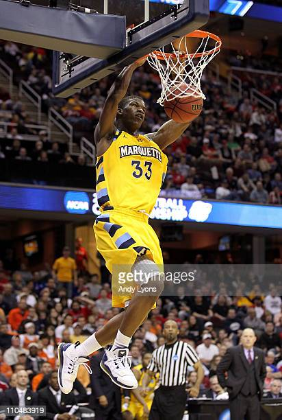 Jimmy Butler of the Marquette Golden Eagles dunks the ball against the Xavier Musketeers during the second round of the 2011 NCAA men's basketball...
